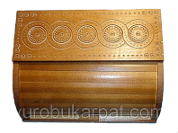 Breadbox with carved ornaments.